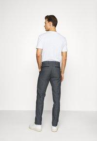 Tommy Hilfiger Tailored - FLEX SLIM FIT PANT - Kalhoty - black - 2