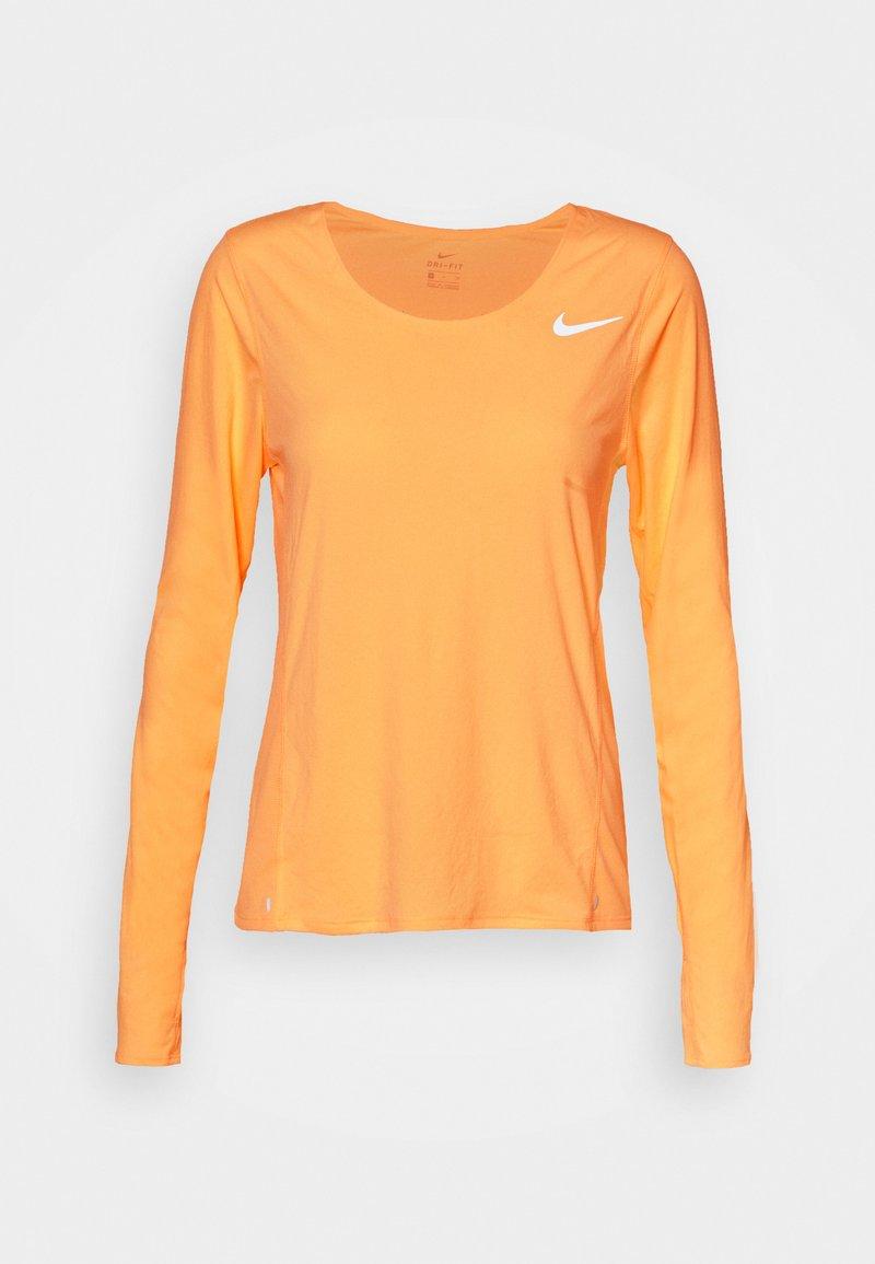 Nike Performance - CITY SLEEK - Sports shirt - melon tint/silver