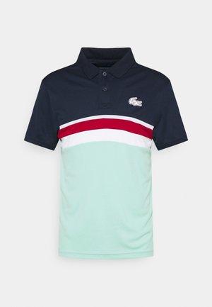 TENNIS - Polo shirt - navy blue/spirulina/ladybird/white