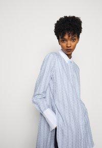 By Malene Birger - EAUBONNE - Button-down blouse - chambray blue - 4