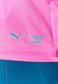Puma - TRAIN FIRST MILE XTREME TANK - Sports shirt - luminous pink - 4