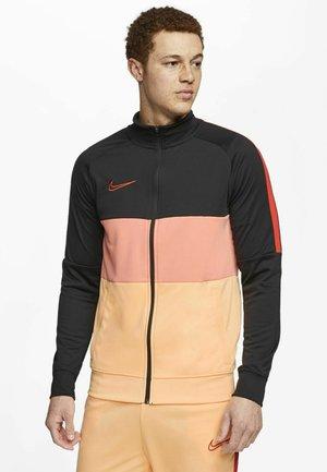 DRY ACADEMY - Training jacket - schwarzpink