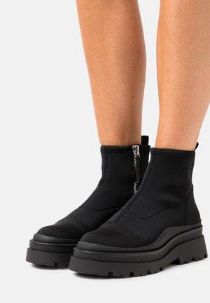 GALLOP - Platform ankle boots - black