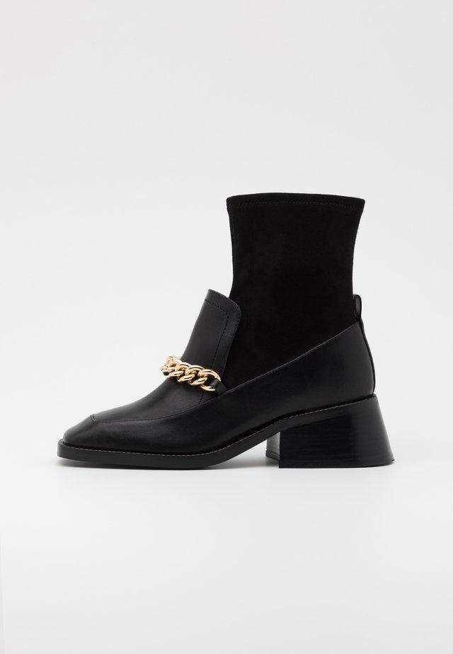 PATRIK - Kotníkové boty - black