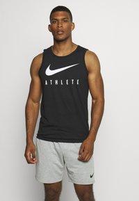 Nike Performance - TANK ATHLETE - Sports shirt - black/white - 0