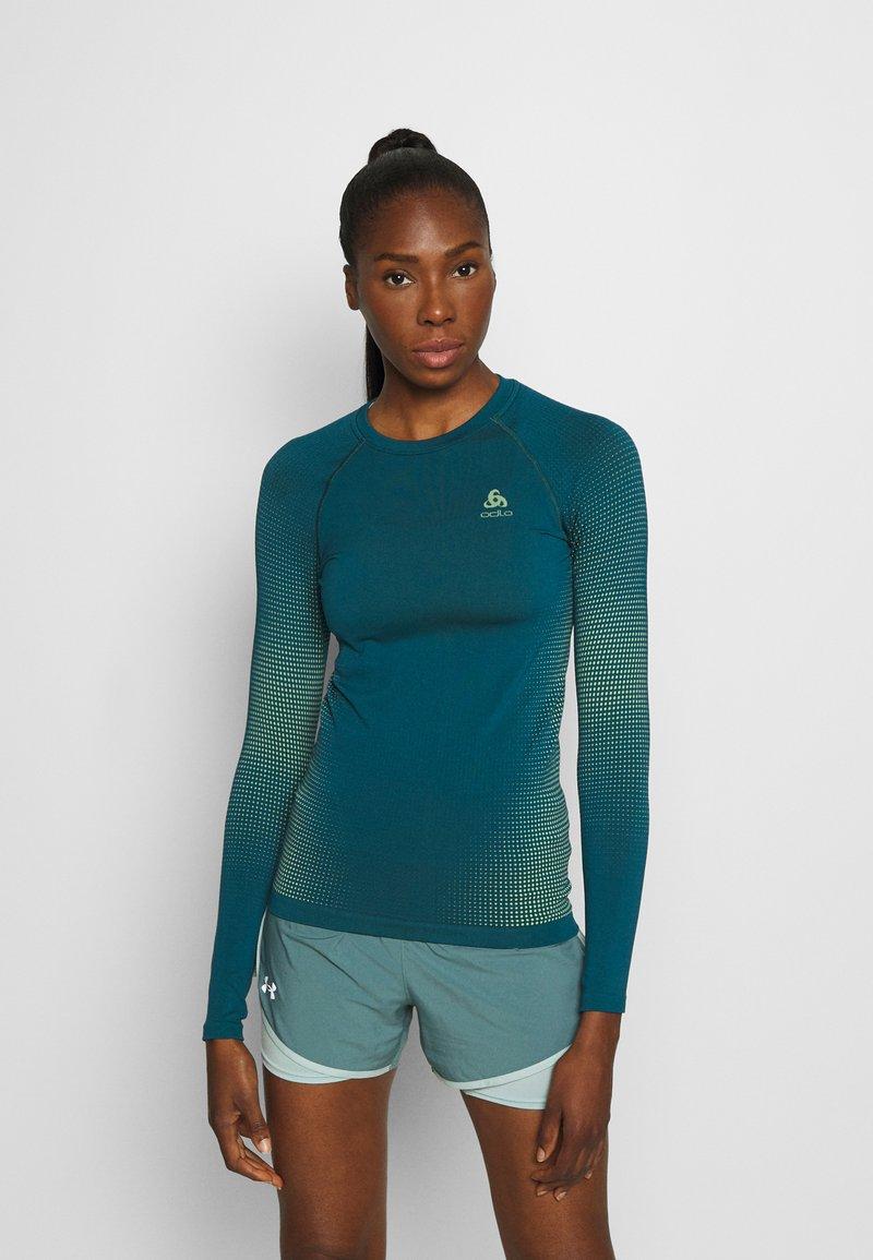 ODLO - CREW NECK PERFORMANCE WARM - Sports shirt - submerged