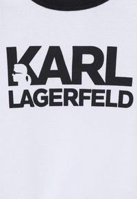 KARL LAGERFELD KIDS - BIB BABY UNISEX - Grenouillère - white/black - 2
