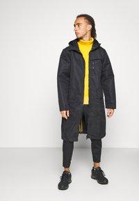 adidas Performance - ATHLETICS TECH SPORTS RELAXED JACKET - Training jacket - black - 1
