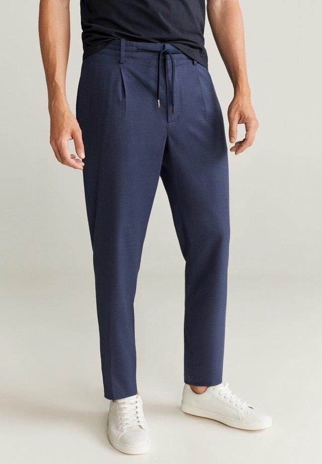 Pantalon classique - dunkles marineblau