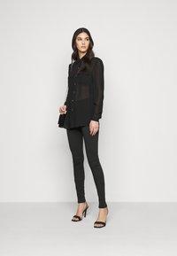 Vero Moda Tall - VMLUX SUPER - Slim fit jeans - black - 1