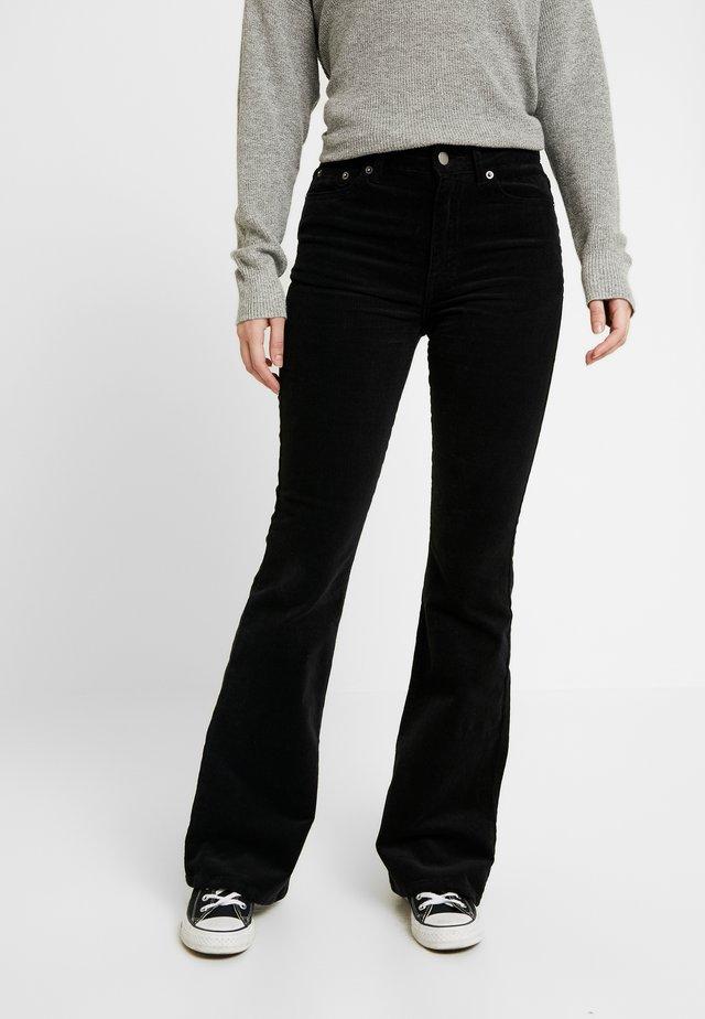 DALLAS - Trousers - black