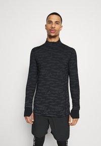 Endurance - ARTY REFLECTIVE MIDLAYER - T-shirt sportiva - black - 0