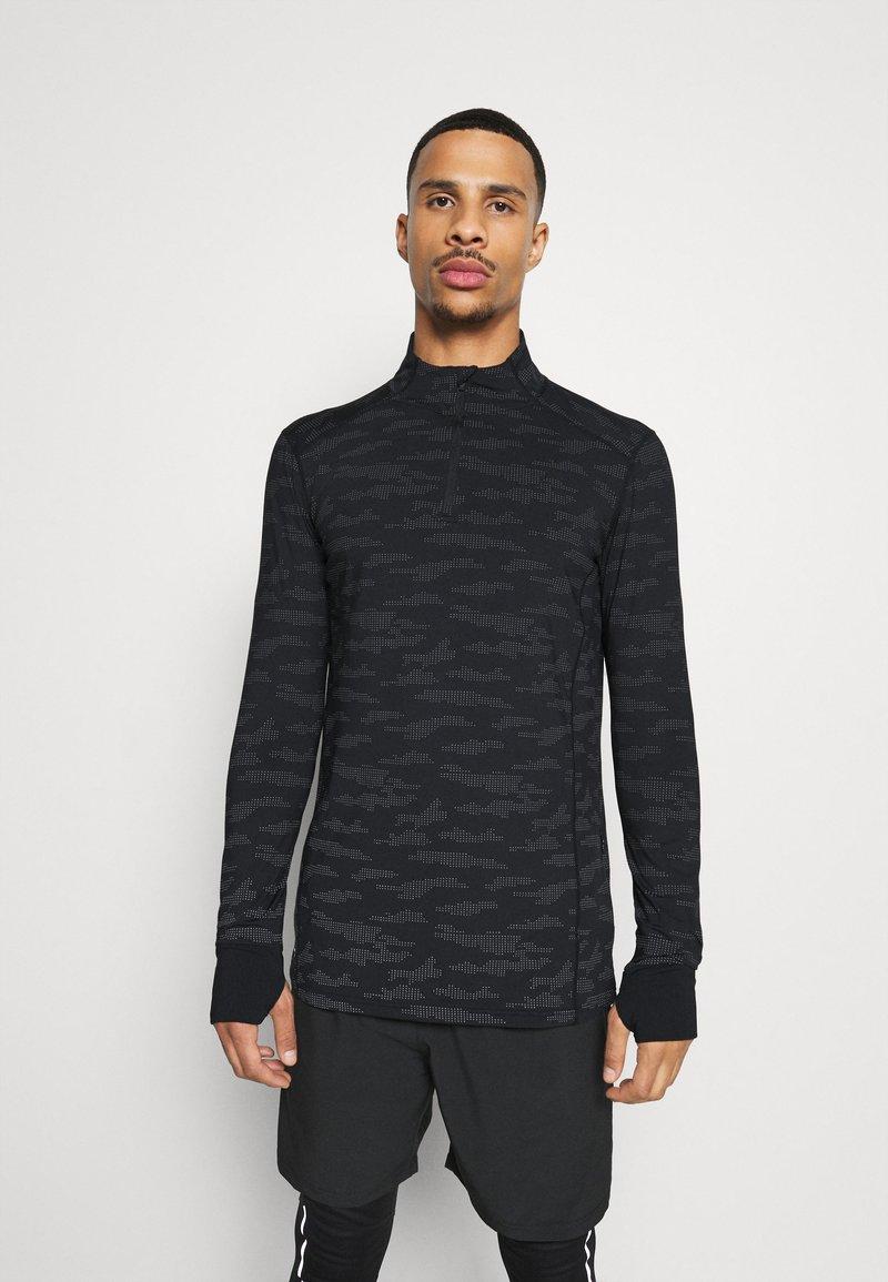 Endurance - ARTY REFLECTIVE MIDLAYER - T-shirt sportiva - black