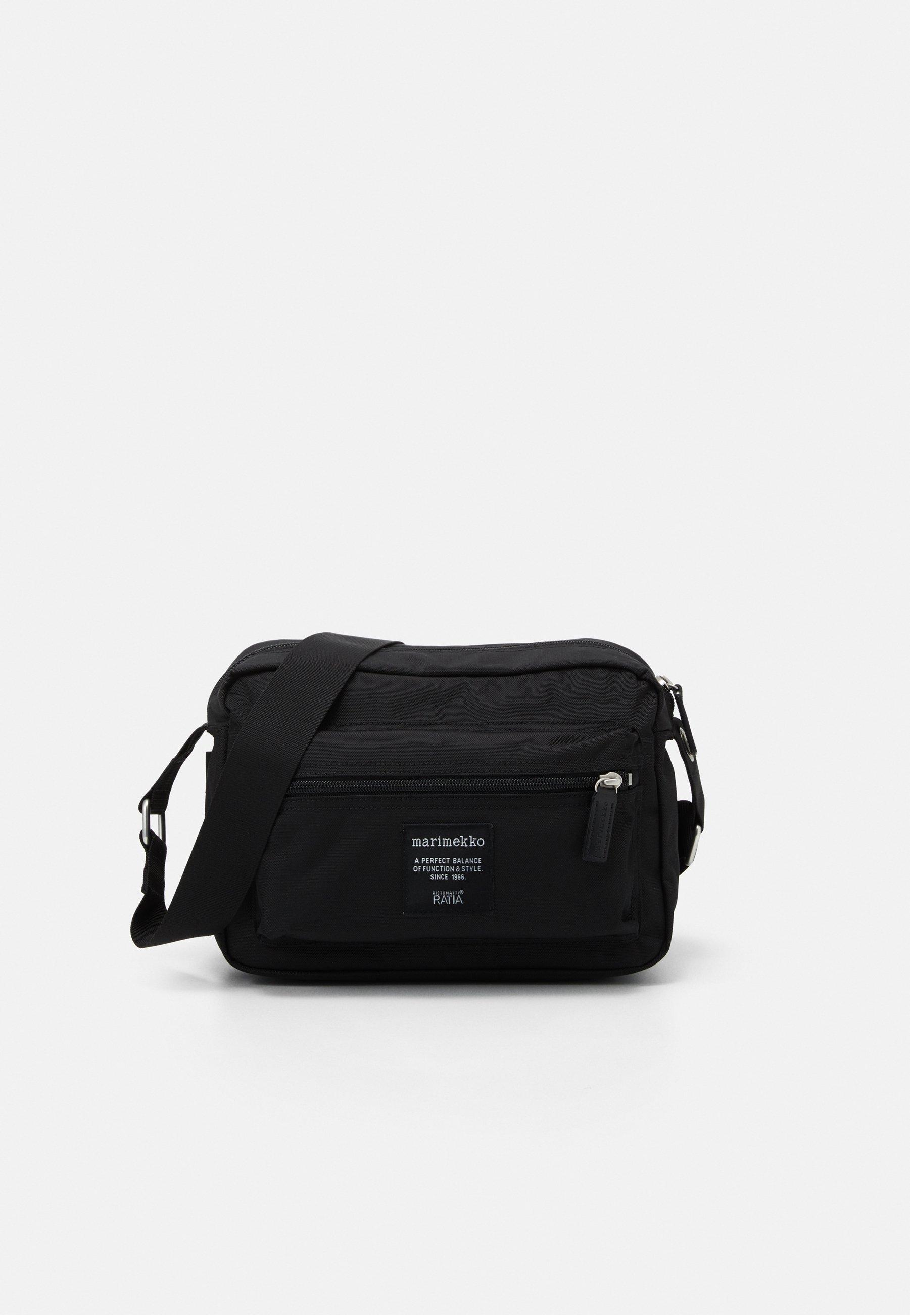 MY THINGS BAG Axelremsväska black