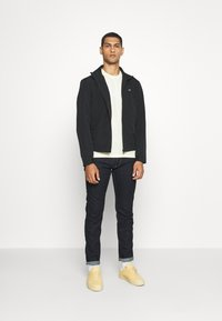 Calvin Klein - CASUAL BLOUSON JACKET - Summer jacket - black - 1