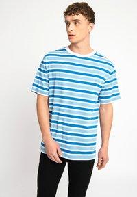 Urban Threads - T-shirts print - blue - 0