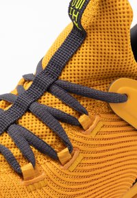Under Armour - HOVR RISE 2 - Sports shoes - golden yellow/yellow ray - 5