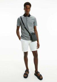 Calvin Klein - Polo shirt - ck black - 1