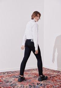 Versace Jeans Couture - Džíny Straight Fit - black - 3