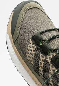 adidas Performance - FREE HIKER BOOST PRIMEKNIT SHOES - Hiking shoes - legend green/core black/sigal green - 5