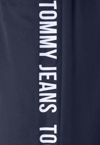 Tommy Jeans - JOGGER TAPE RELAXED - Tracksuit bottoms - twilight navy - 5
