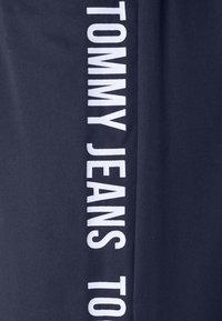 Tommy Jeans - JOGGER TAPE RELAXED - Pantalon de survêtement - twilight navy - 5