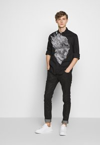 Just Cavalli - ANIMAL PATTERN PANTS 5 POCKETS - Jeans Slim Fit - black - 1