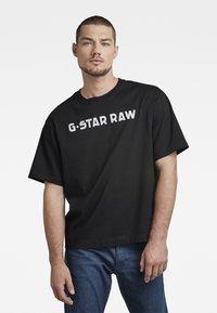 G-Star - FLOCK BOXY R T UNISEX  - Print T-shirt - dry jersey o dk black - 2