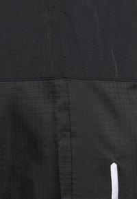 Karl Kani - SIGNATURE PANTS UNISEX - Pantalon cargo - black - 2