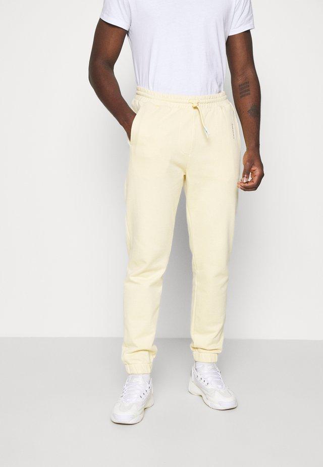 UNISEX - Teplákové kalhoty - flax