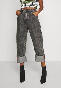 Diesel - D-REGGY - Relaxed fit jeans - black - 0