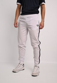 sergio tacchini - YOUNG LINE - Tracksuit bottoms - wht/nav - 0