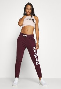 Reebok - LINEAR LOGO PANT - Pantalones deportivos - maroon - 1
