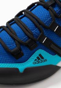 adidas Performance - TERREX SWIFT SOLO - Climbing shoes - royal blue/core black/signal cyan - 5