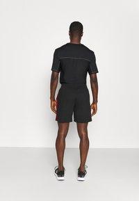 adidas Performance - Krótkie spodenki sportowe - black/scarlet - 3