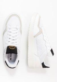 adidas Originals - SUPERCOURT - Sneakers - footwear white/core black - 1