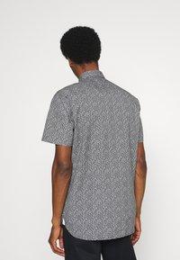 Tommy Hilfiger - SOFT MINI FLORAL PRINT - Shirt - black/white /lumen flash - 2