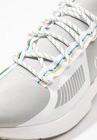 Reebok - SOLE FURY TS - Sports shoes - grey/white/cyan - 5