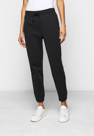ONCE - Tracksuit bottoms - schwarz