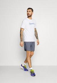Nike Performance - TEE - Triko spotiskem - white - 1