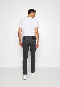 Tommy Hilfiger - SLIM BLEECKER AGAR  - Slim fit jeans - black denim - 2