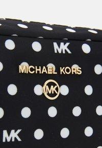 MICHAEL Michael Kors - JET CHARM ZIP TRAVEL POUCH - Wash bag - black/optic white - 4