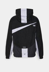 Nike Sportswear - Windbreaker - black/anthracite/white - 1