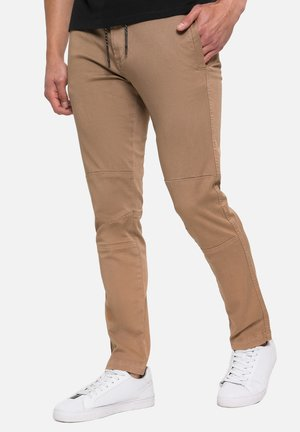 Carden - Trousers - stone