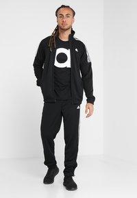 adidas Performance - ATHLETICS TEAM SPORTS TRACKSUIT - Tracksuit - black/white - 1