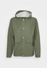 SHORT HOODED COAT UNISEX - Waterproof jacket - olive
