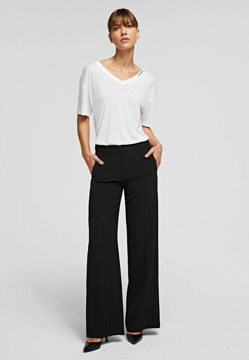 KARL LAGERFELD - Trousers - black