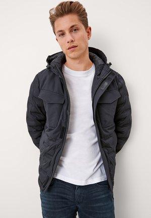 MET VAN EEN MATERIAALMIX - Winter jacket - black