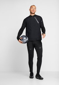 Nike Performance - DRIL - Camiseta de deporte - black - 1