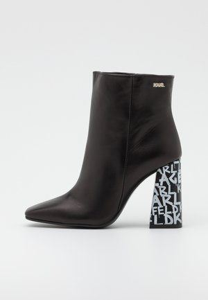 GRAFFITI  - High heeled ankle boots - black/white